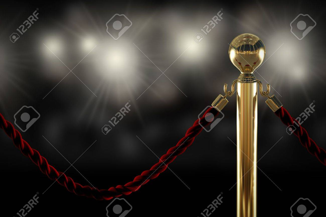 Red velvet rope barrier close-up with flash light on background Stock Photo - 20839578