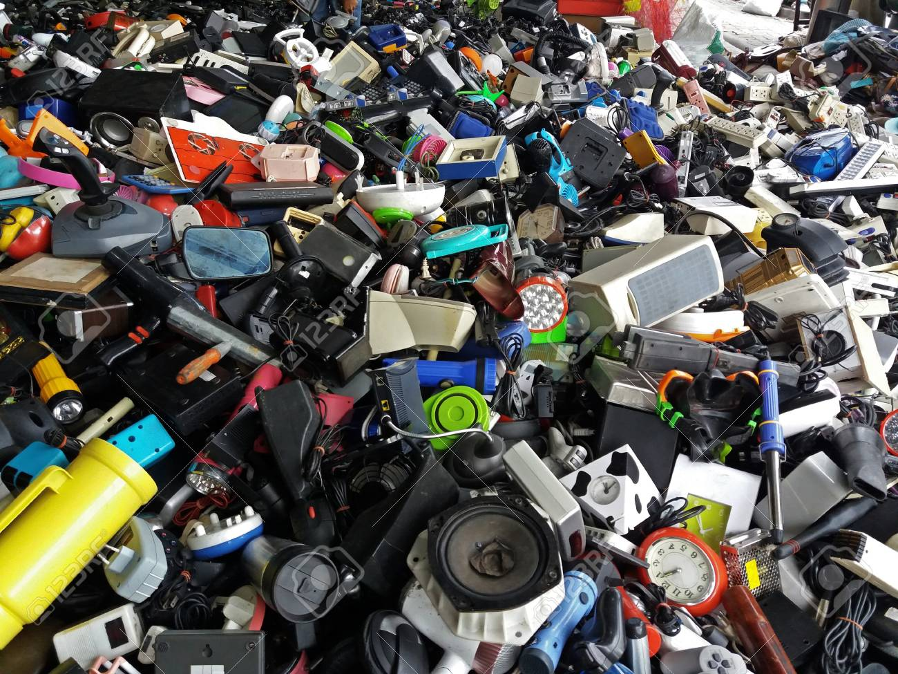 Pile of used Electronic and Housewares Waste Division broken or damage for Reuse and Recycle - 98018379