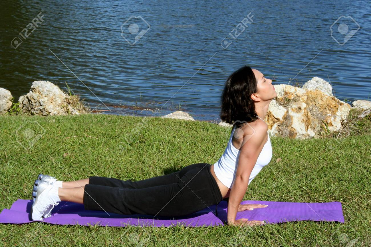 Woman at a park doing yoga poses Stock Photo - 687118