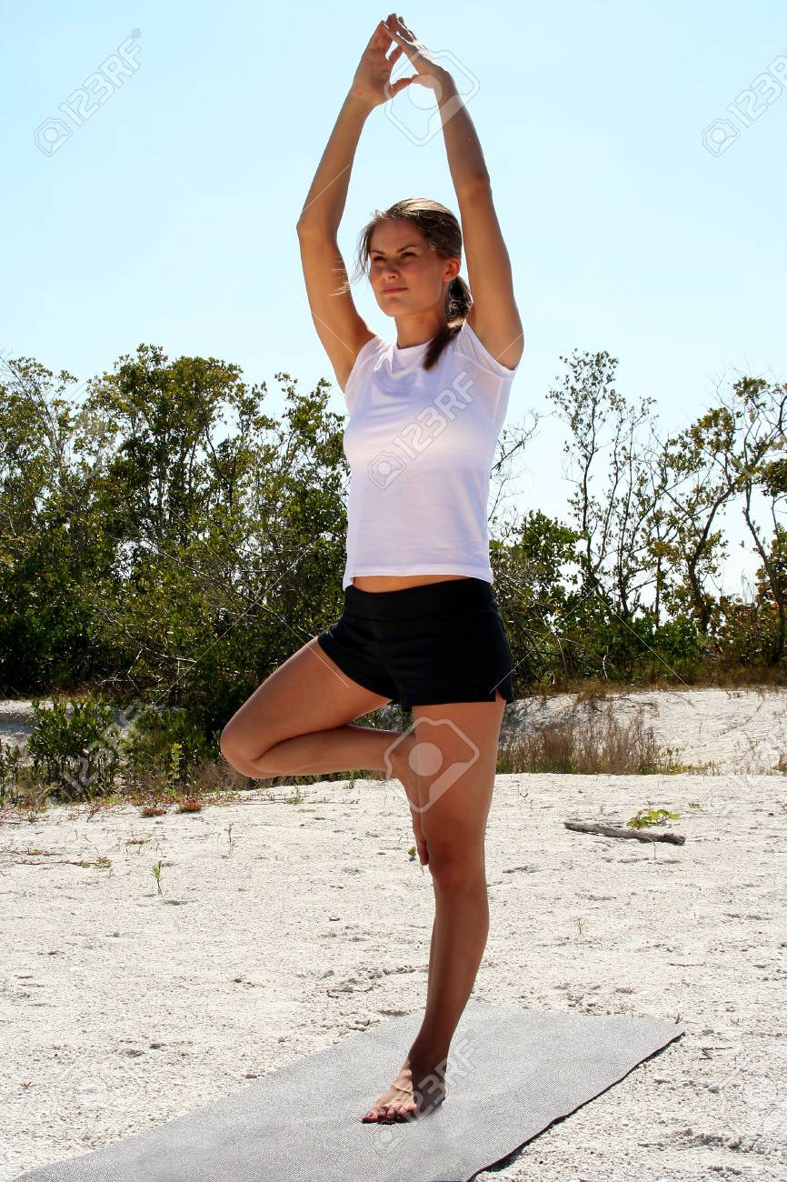 Attractive woman on beach doing yoga poses Stock Photo - 840287
