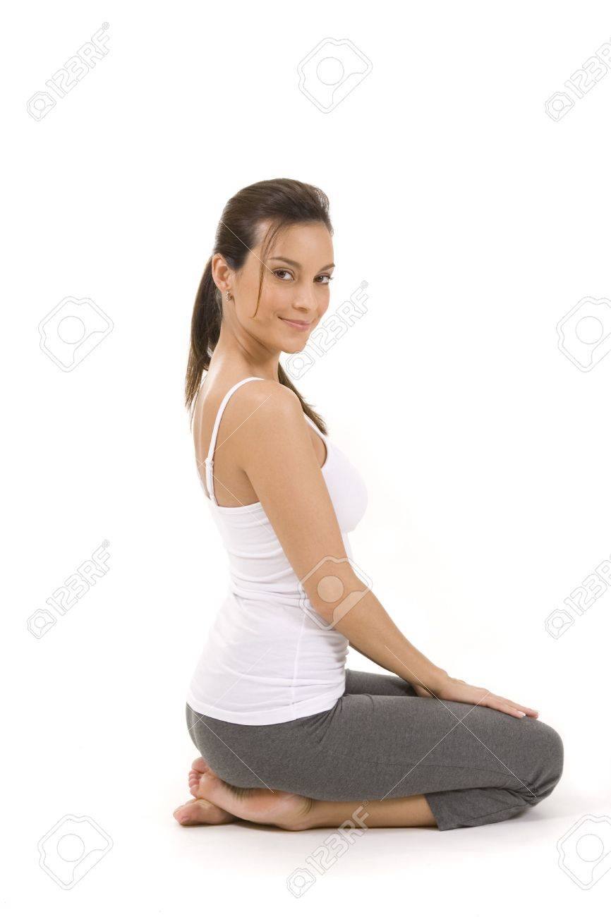 Young woman on white background in a fitness pose Stock Photo - 5088618