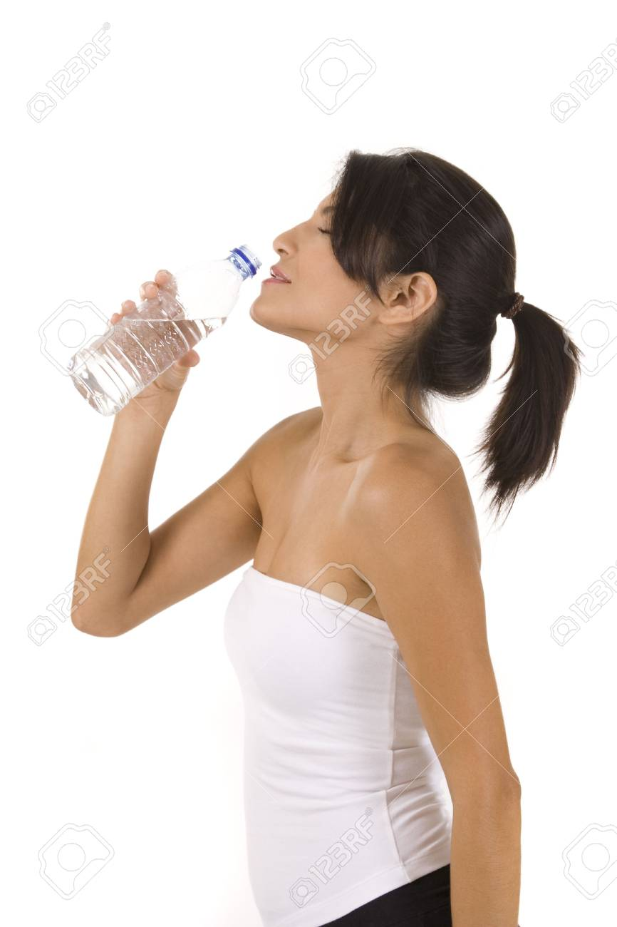Woman drinking water on white Stock Photo - 5215021