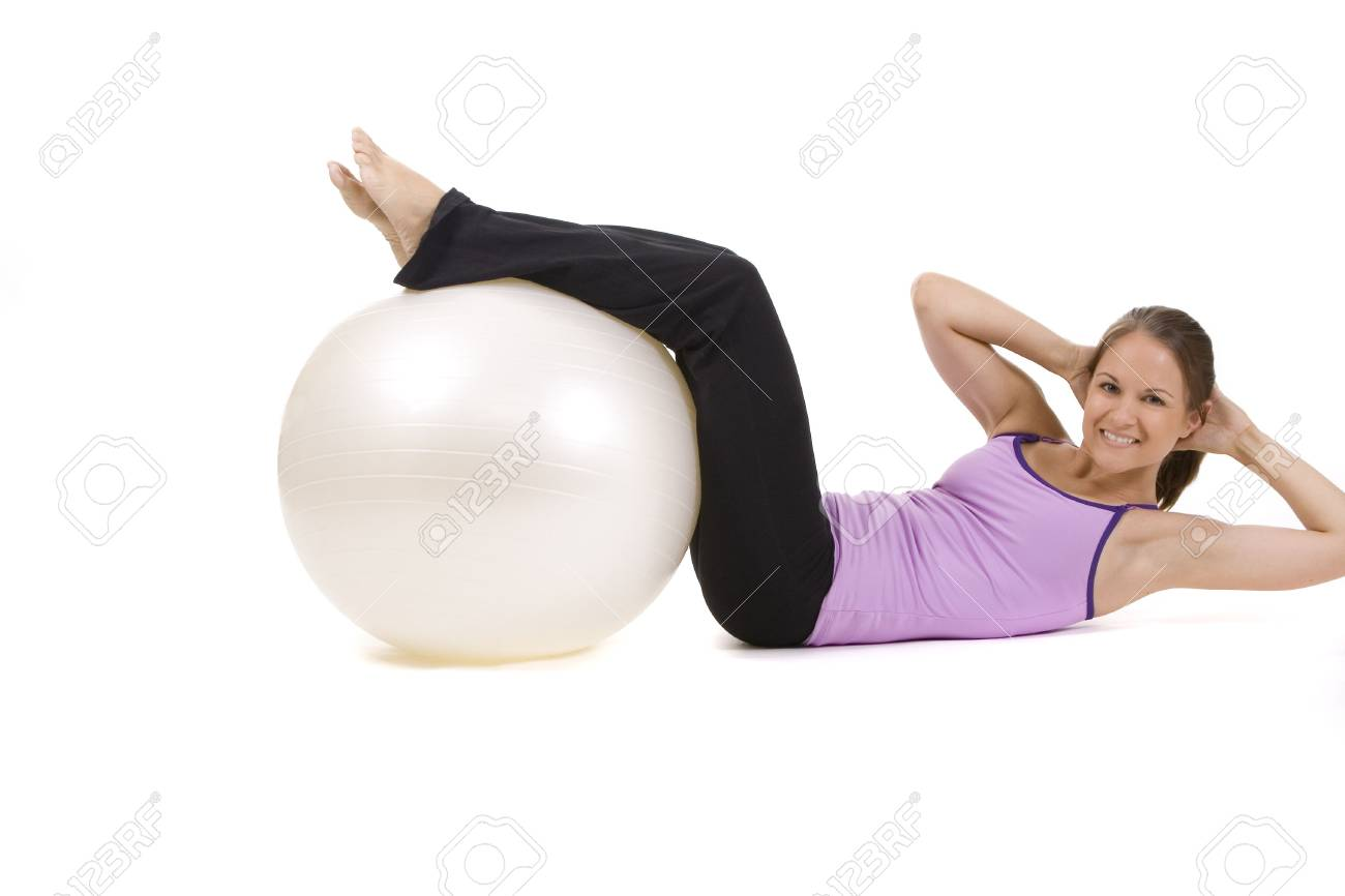 Young woman on white background in a fitness pose Stock Photo - 5282198