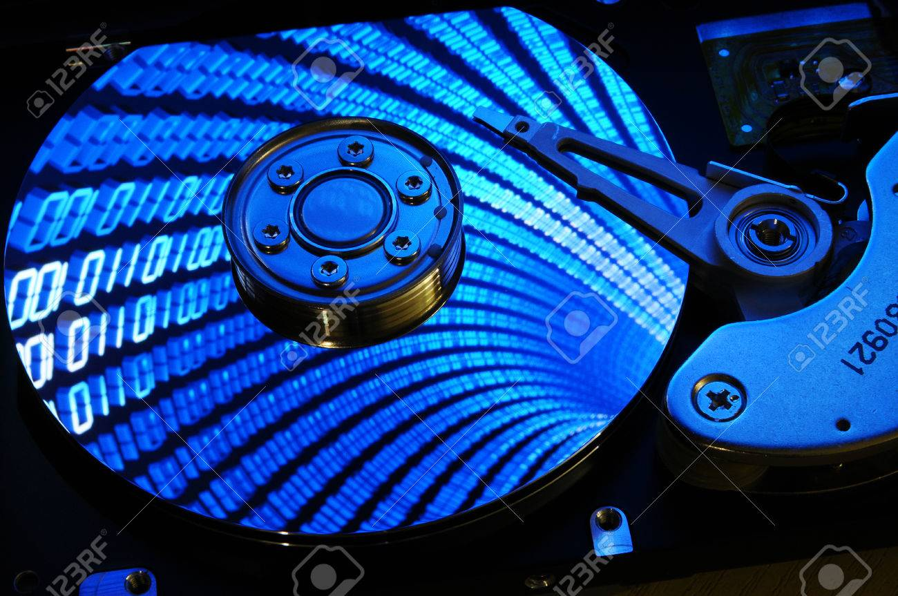Close Up Of Computer Hard Drive Disc With Binary Effects Reflected