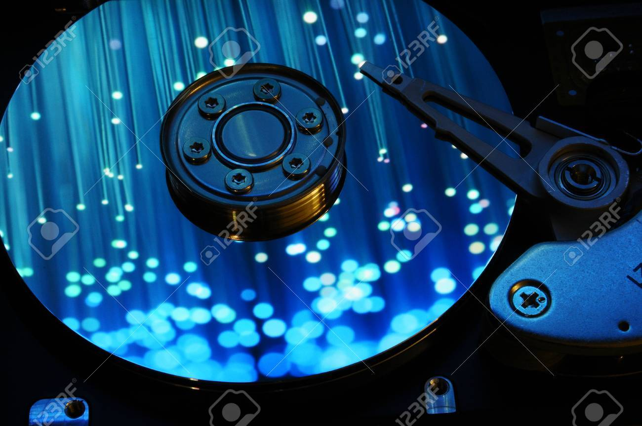 Close Up Of Computer Hard Drive Disc With Colors Reflected On