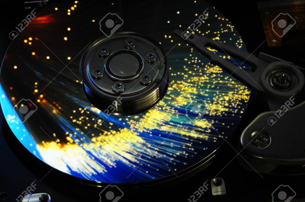 Close Up Of Computer Hard Drive Disc With Abstract Colors Reflected