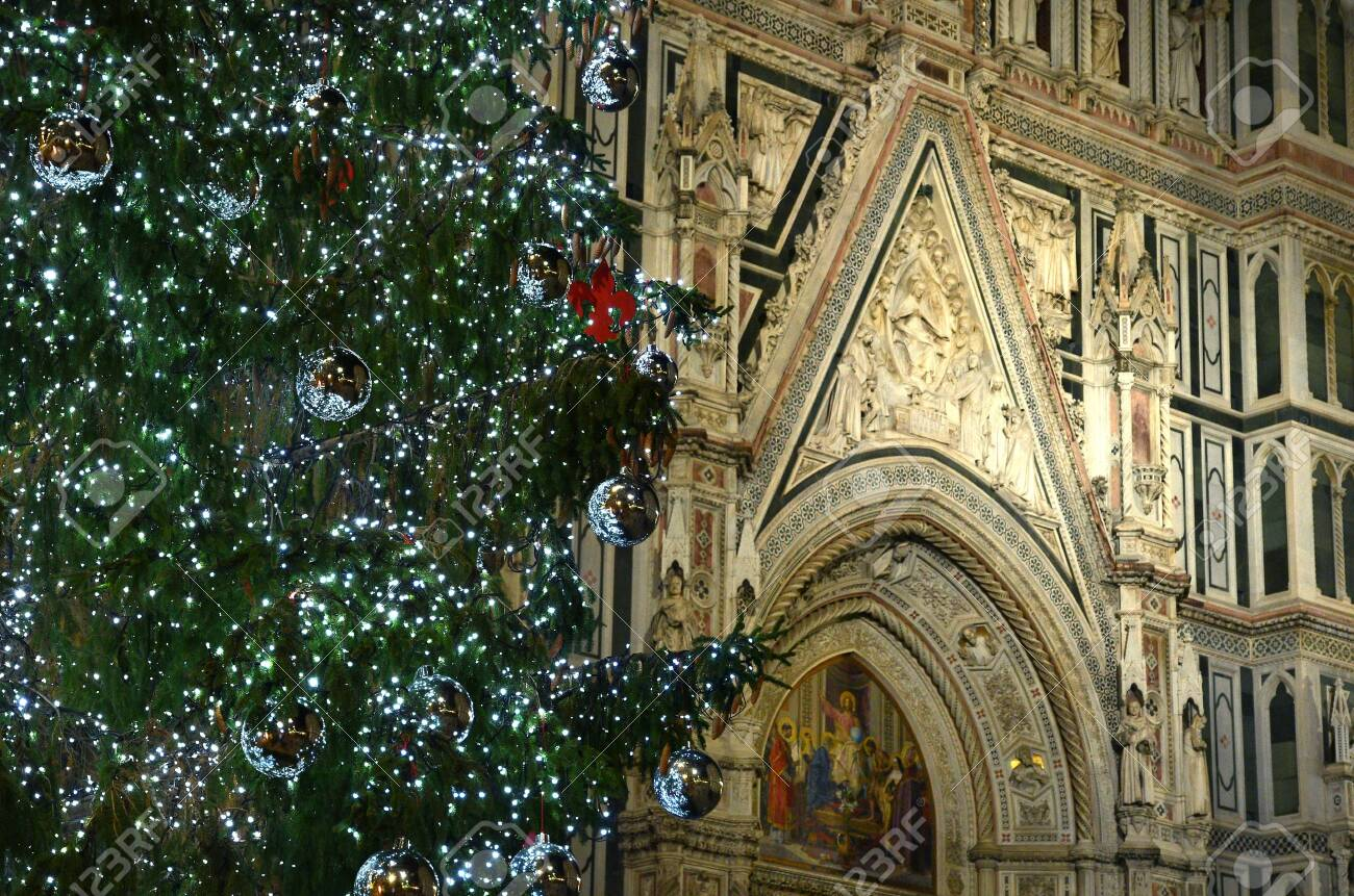 Christmas In Florence Italy.Illuminated Christmas Tree With Santa Maria Del Fiore On The