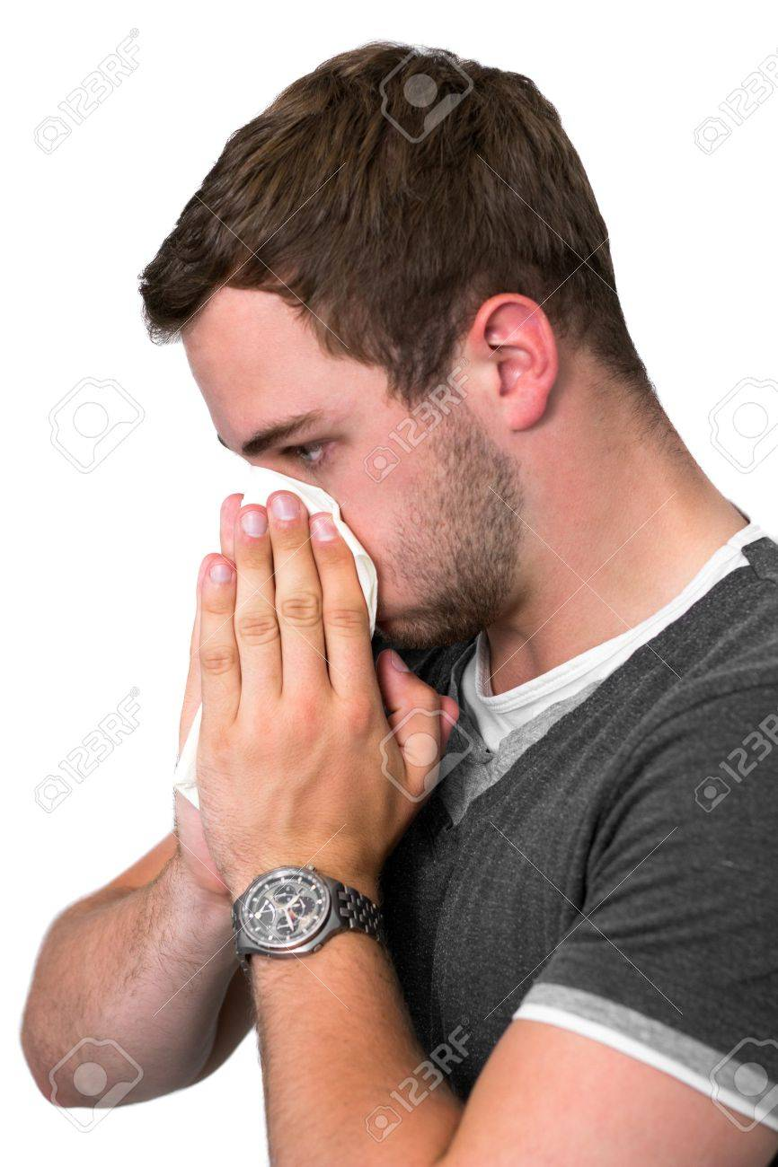 Young Man Blowing Nose into a tissue Stock Photo - 14749593
