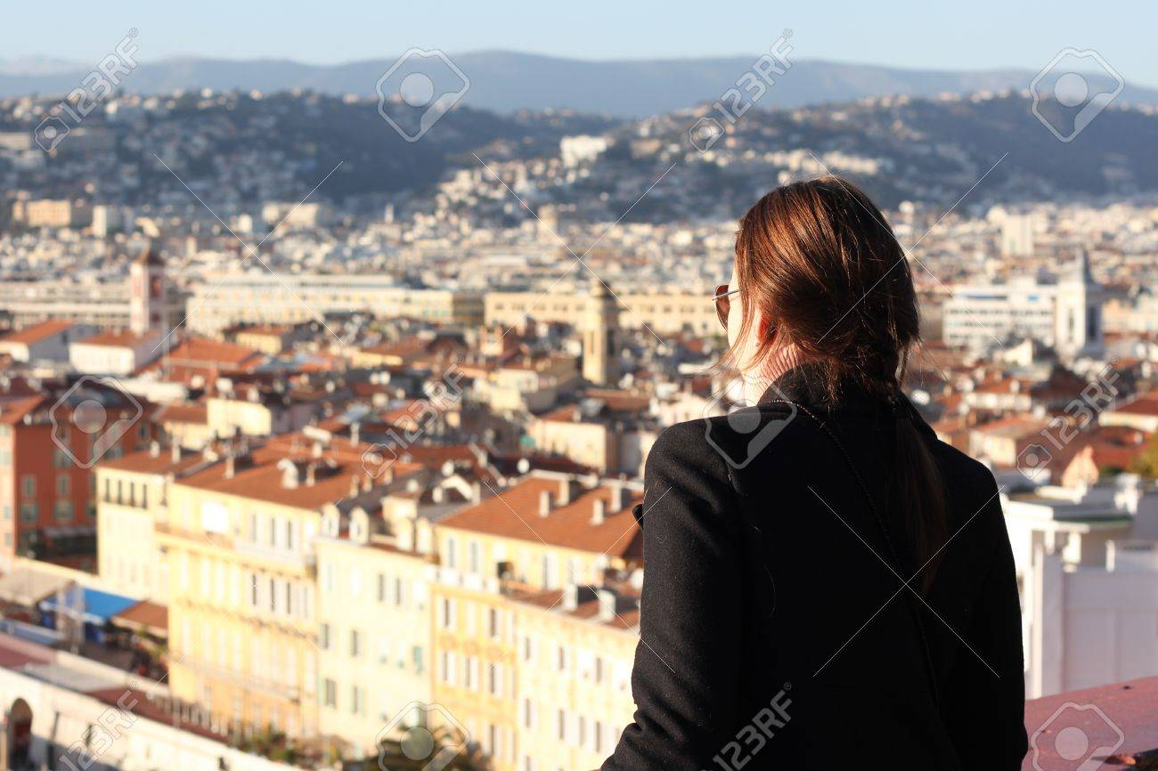 Woman looking down at the City of Nice in South of France Stock Photo - 14928964