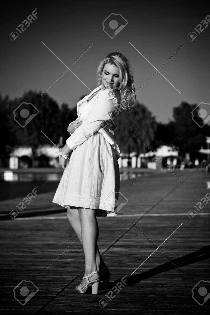 Model standing on a wooden pier - 14929578