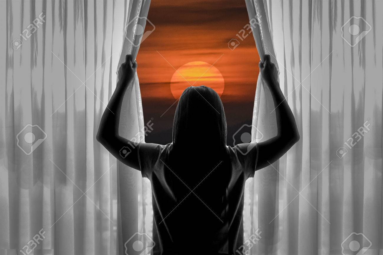https://previews.123rf.com/images/danflcreativo/danflcreativo1606/danflcreativo160600352/59045699-back-view-of-silhouette-of-young-woman-opening-curtains-against-sunset-background-.jpg
