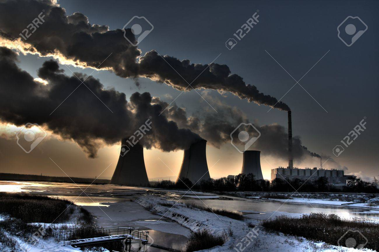 Coal powerplant - sun,  chimneys and fumes Stock Photo - 6353975