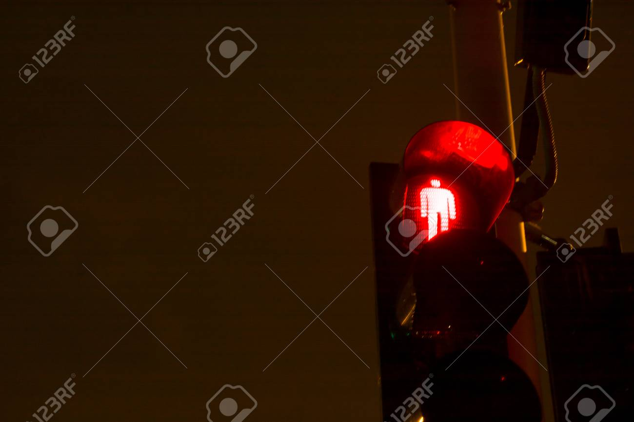 Stock Photo   Traffic Light Showing A Red Person In Order To Advice To Not  Cross The Street At Night