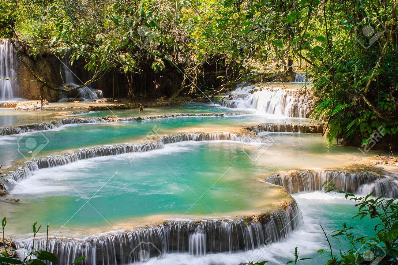The Kuang Si Falls is a multi-level waterfall about 30 kilometers south of Luang Prabang - 144258375