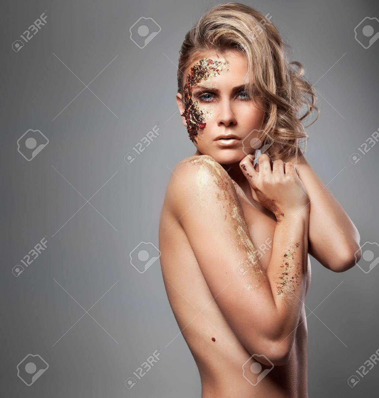 Vogue style photo of a blond woman with colorful makeup Stock Photo - 10019521