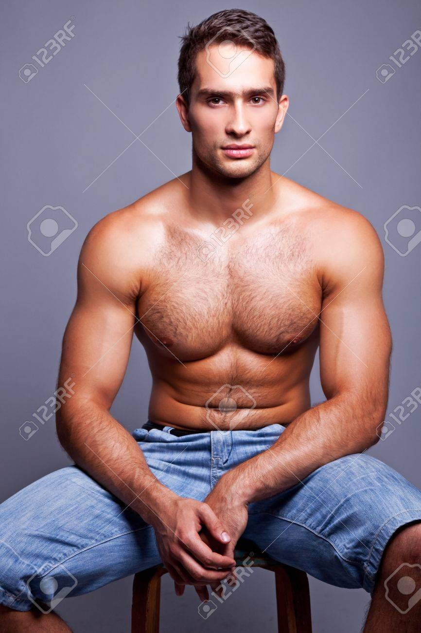 muscular man sitting on a chair Stock Photo - 10019598