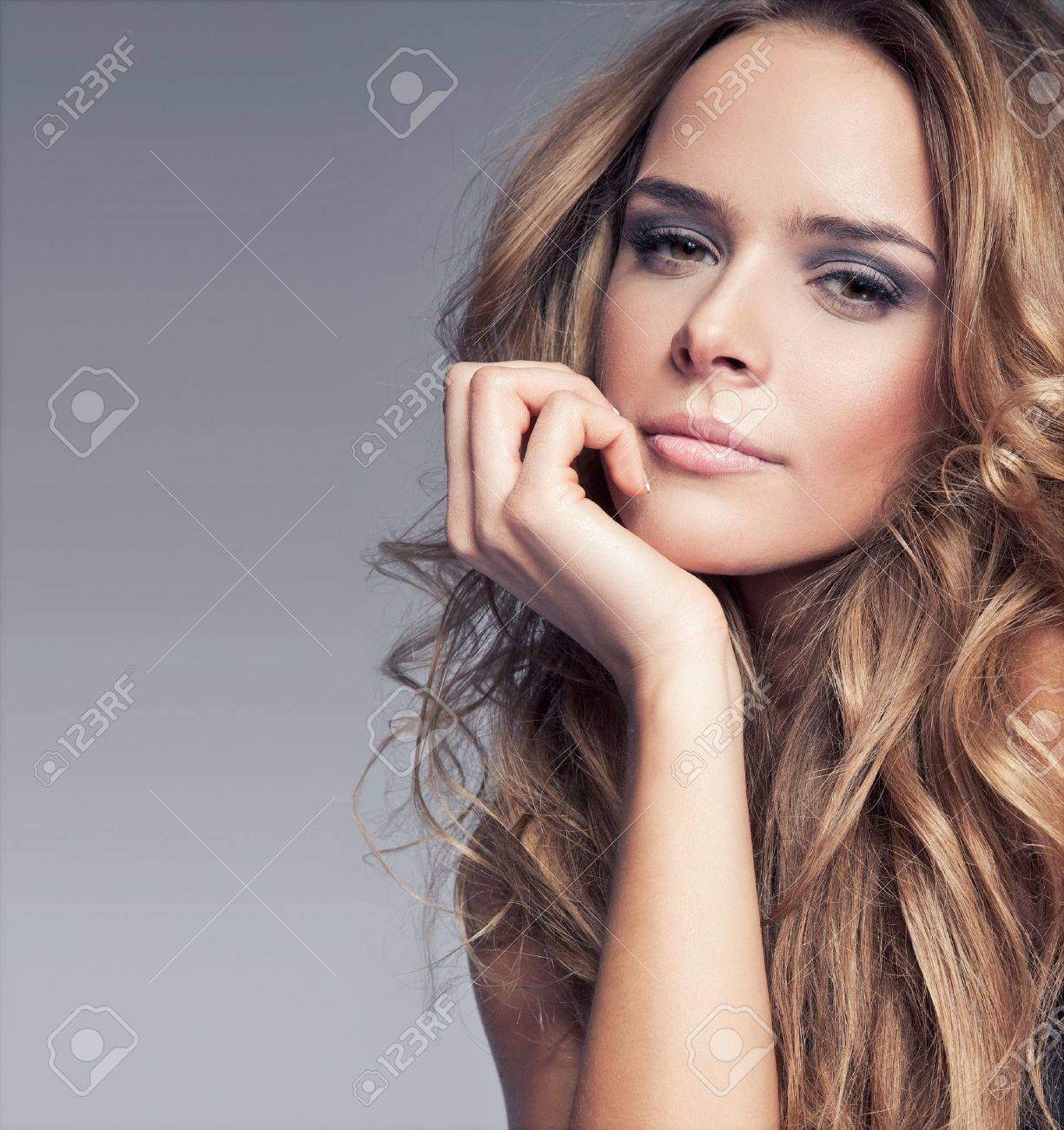 Portrait of beautiful delicate woman on gray background Stock Photo - 12406808