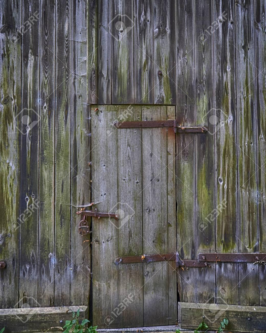 Old Weathered Wooden Barn Door With Steel Hinges Stock Photo   114123880