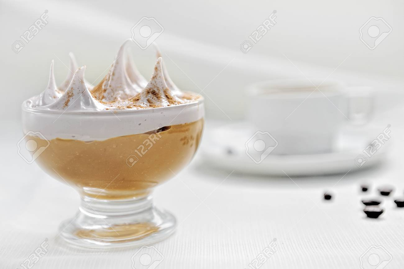 Traditional Peruvian dessert called suspiro a la lime a. On a white background. Accompanied with a coffee. - 106417224