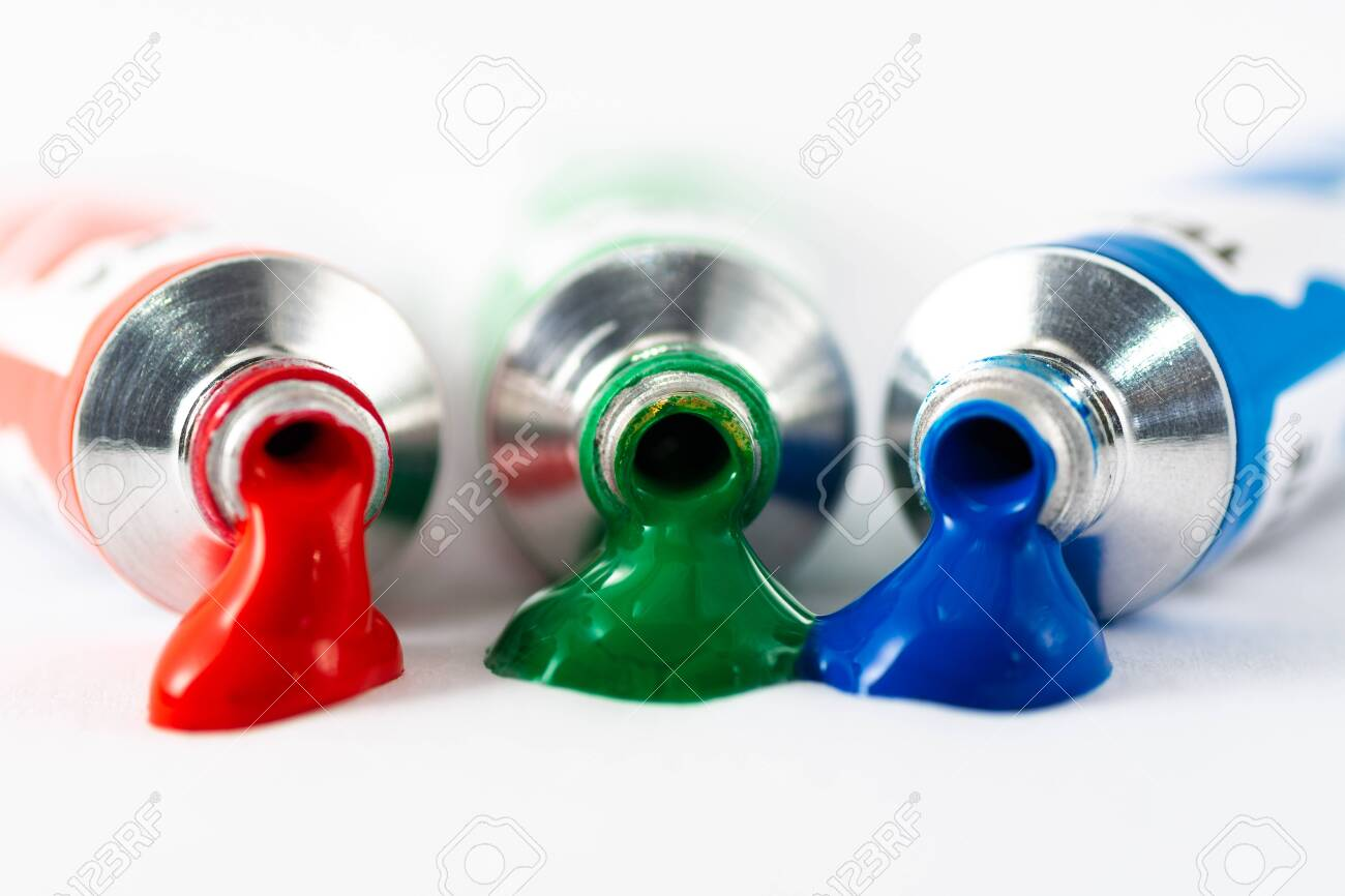 Gouache tube dripping red, blue and greenpaint. White background. RGB color space - 131686736
