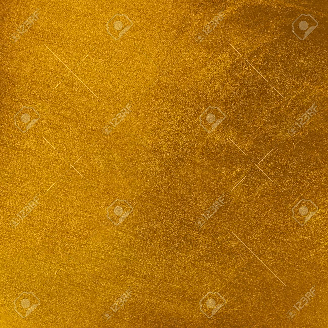 Golden Color Background For Christmas Stretched Marks Rough And Rustic Textured Surface Stock