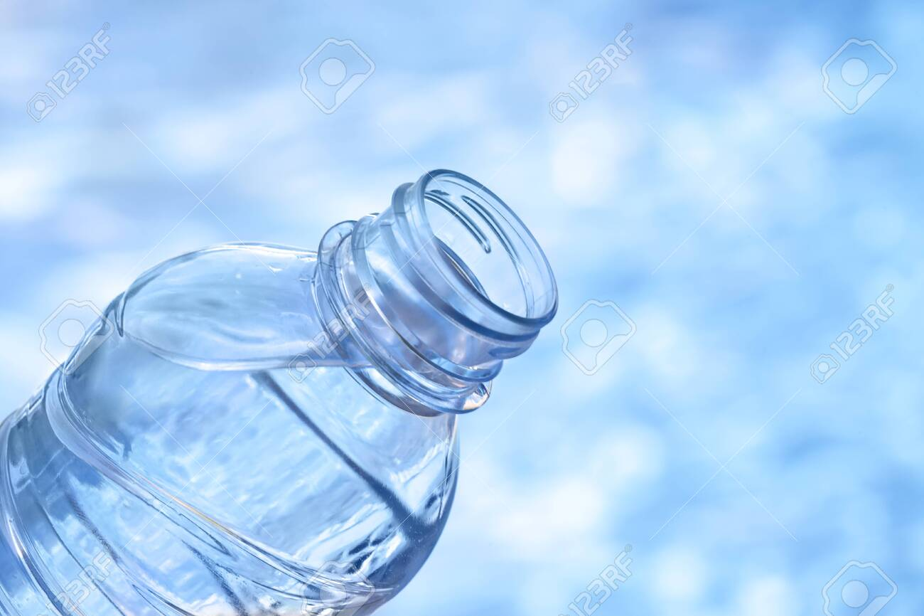 Water plastic bottle against blue background - 131991148