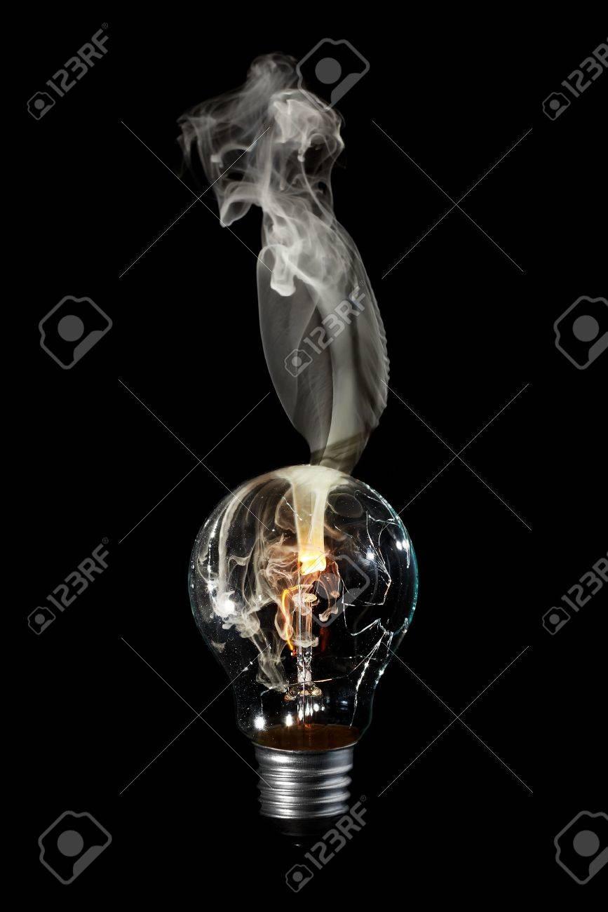 Light bulb with burns out with white smoke