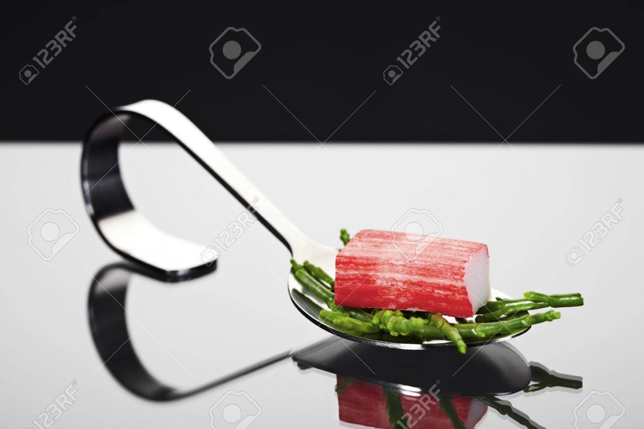 Appetizer spoon with surimi and common glasswort Stock Photo - 11546969