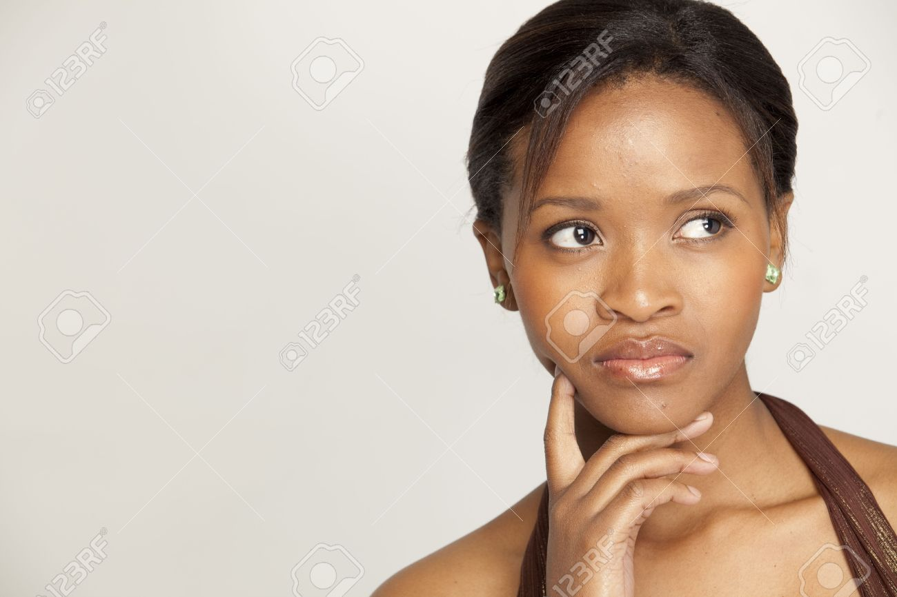 young blakc Stock Photo - Young black woman looking pensive