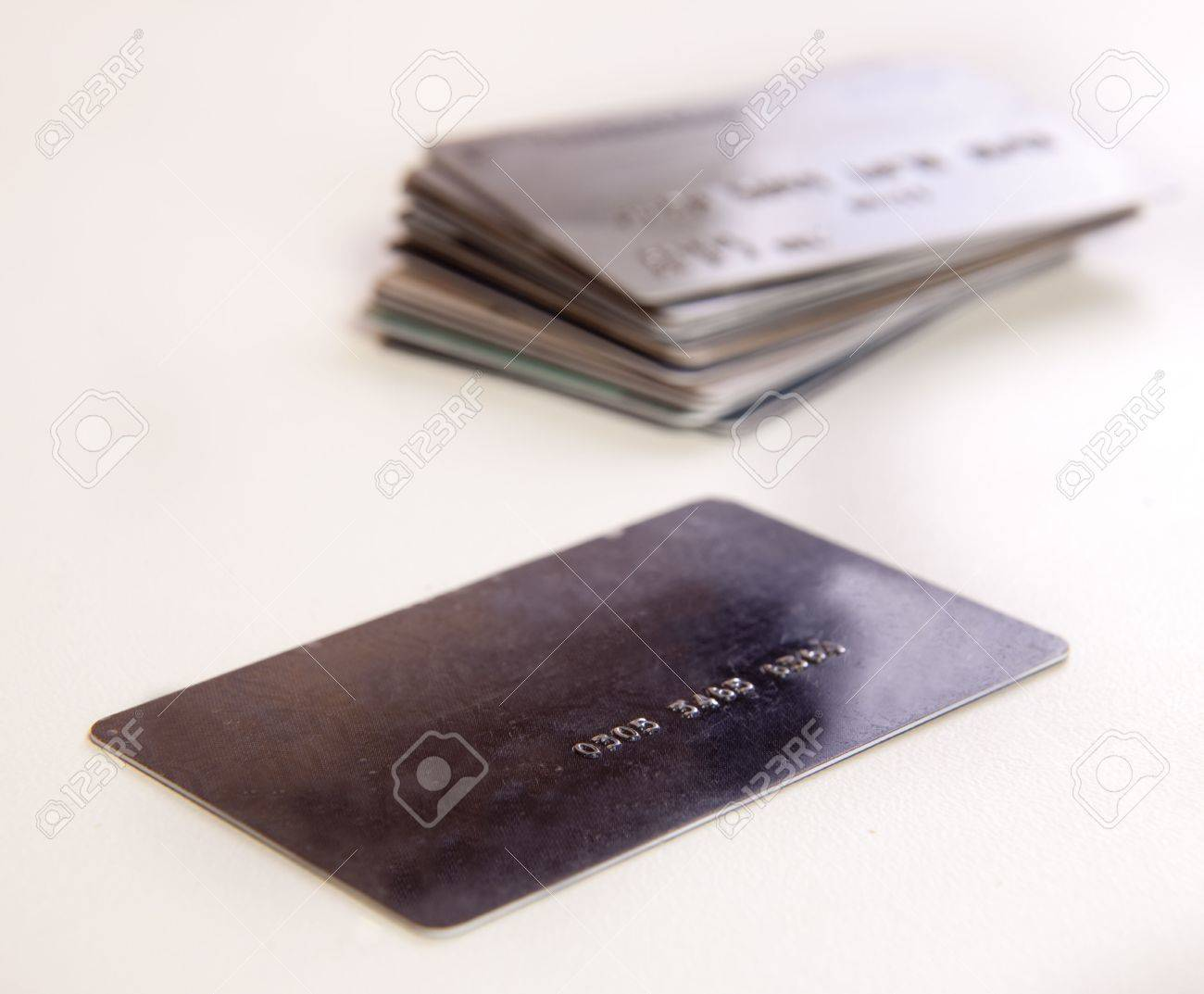 Stack of credit cards on a white background. Stock Photo - 7833024