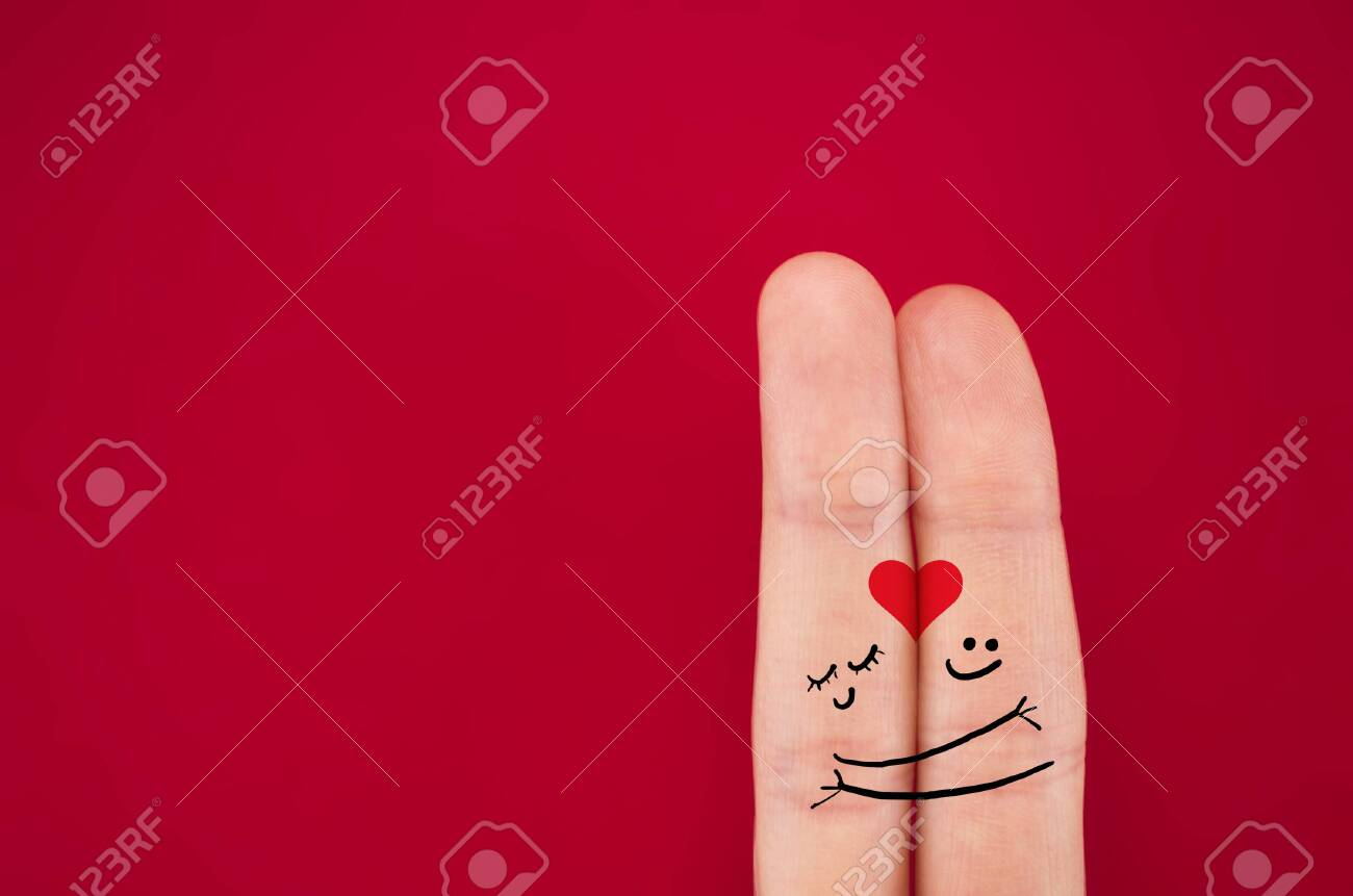 fingers coupled together with a painted heart, a cheerful smile, smileys, emojis, isolated on red background, the symbol of lbwi, relationships - 139861102