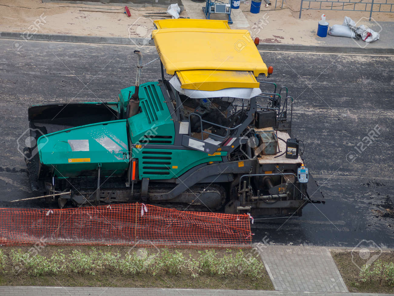 Industrial heavy road paver multifunctional modern, repair of road pavement in an urban environment, noisy work in the city - 166367344