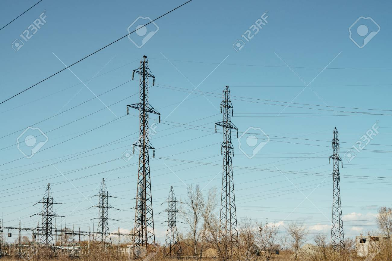 Group Of Posts With Wires High Voltage On Background Blue Sky Wiring Image