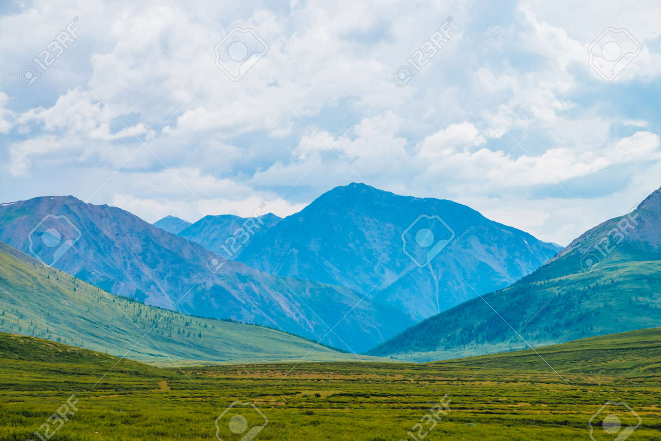 Spectacular view of giant mountains under cloudy sky. Huge mountain range at overcast weather. Wonderful wild scenery. Atmospheric dramatic highland landscape of majestic nature. Scenic mountainscape. - 122914920