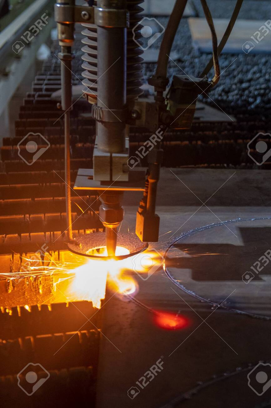 Gas cutting of sheet steel on a machine with numerical control. Splashes of molten metal. - 150630623