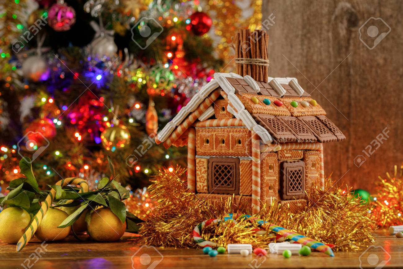 Beautifully Decorated Christmas Tree And Gingerbread House With
