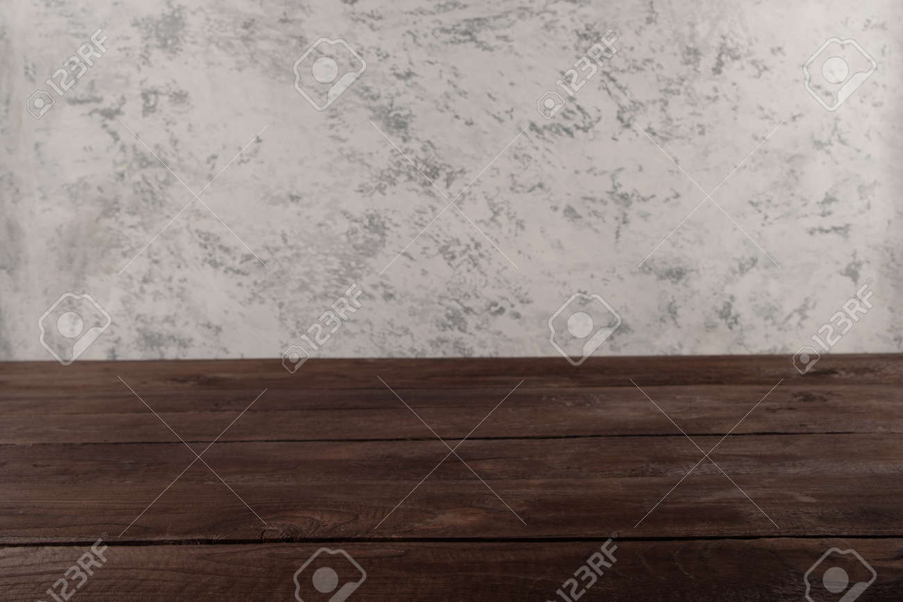 Image of textural table in front of abstract blurred background. Empty textural table platform over background for present product. - 148861402
