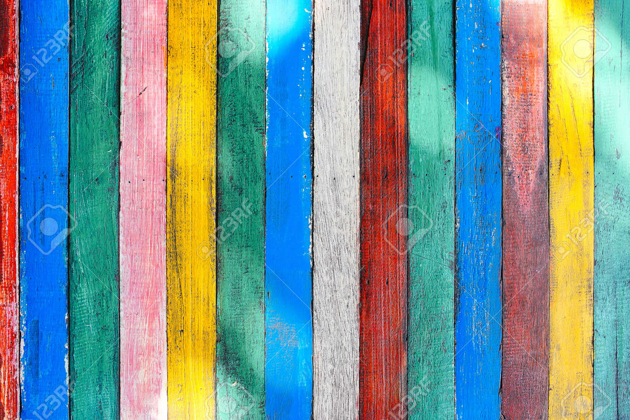 Mulricolored wooden table board surface background or wallpaper. Thin colorful vertical rough boards with knife marks - 166116395