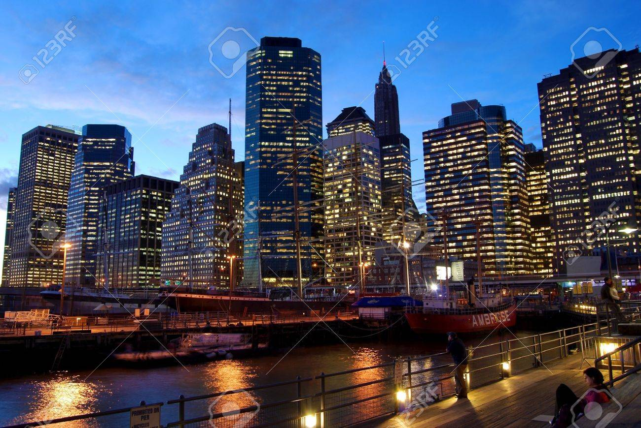 Manhattan at dusk  Nice view from the pier  Illuminated buildings of the financial center  Stock Photo - 15294408