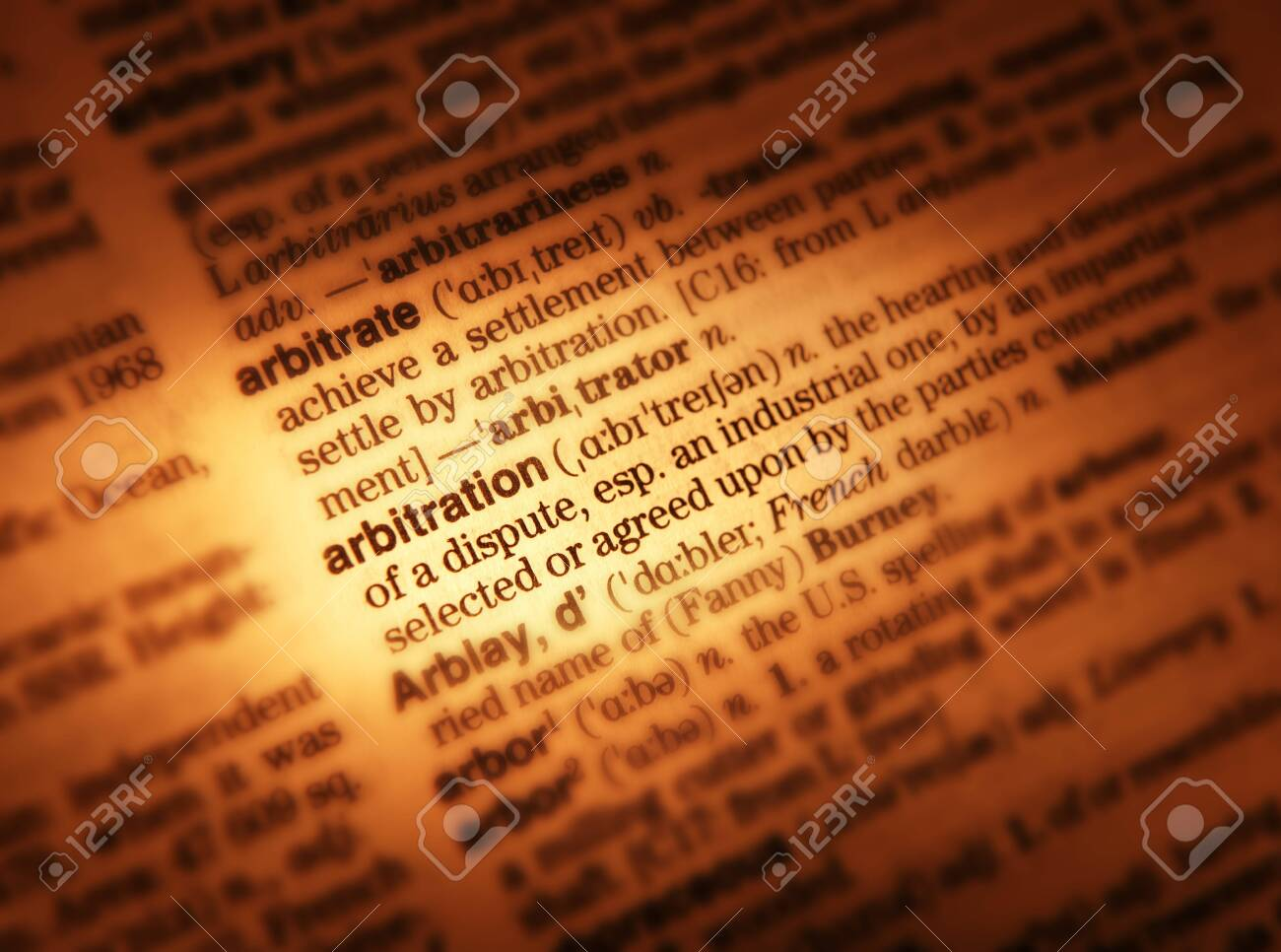 Close up of dictionary showing definition of the word arbitration
