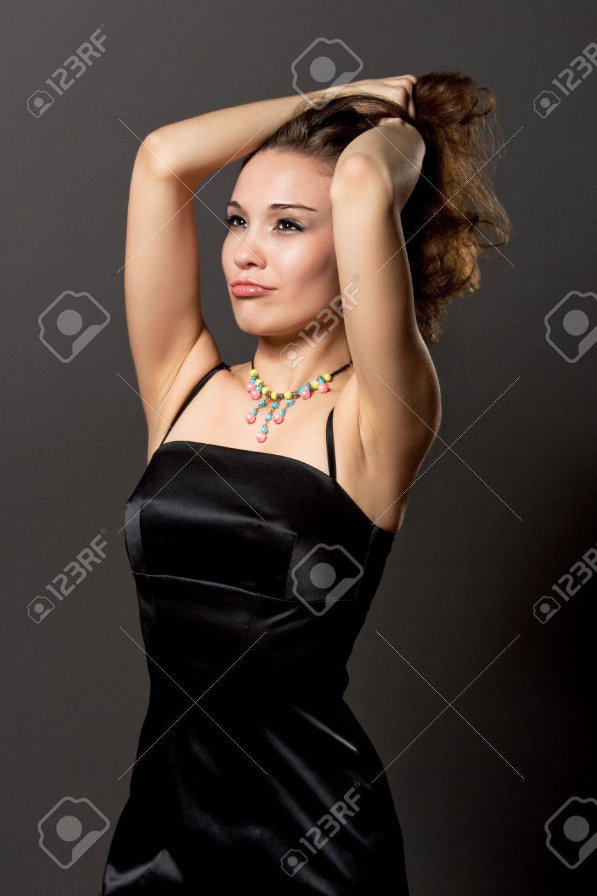 sensual dark hair girl with sensual look standing with hands lifted isolated Stock Photo - 6244356
