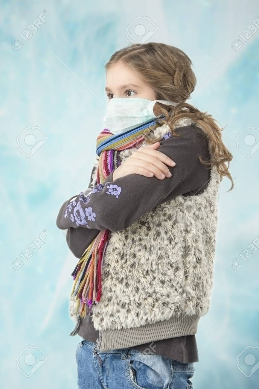 portrait of young caucasian girl wearing facial mask and getting frozen Stock Photo - 17106791