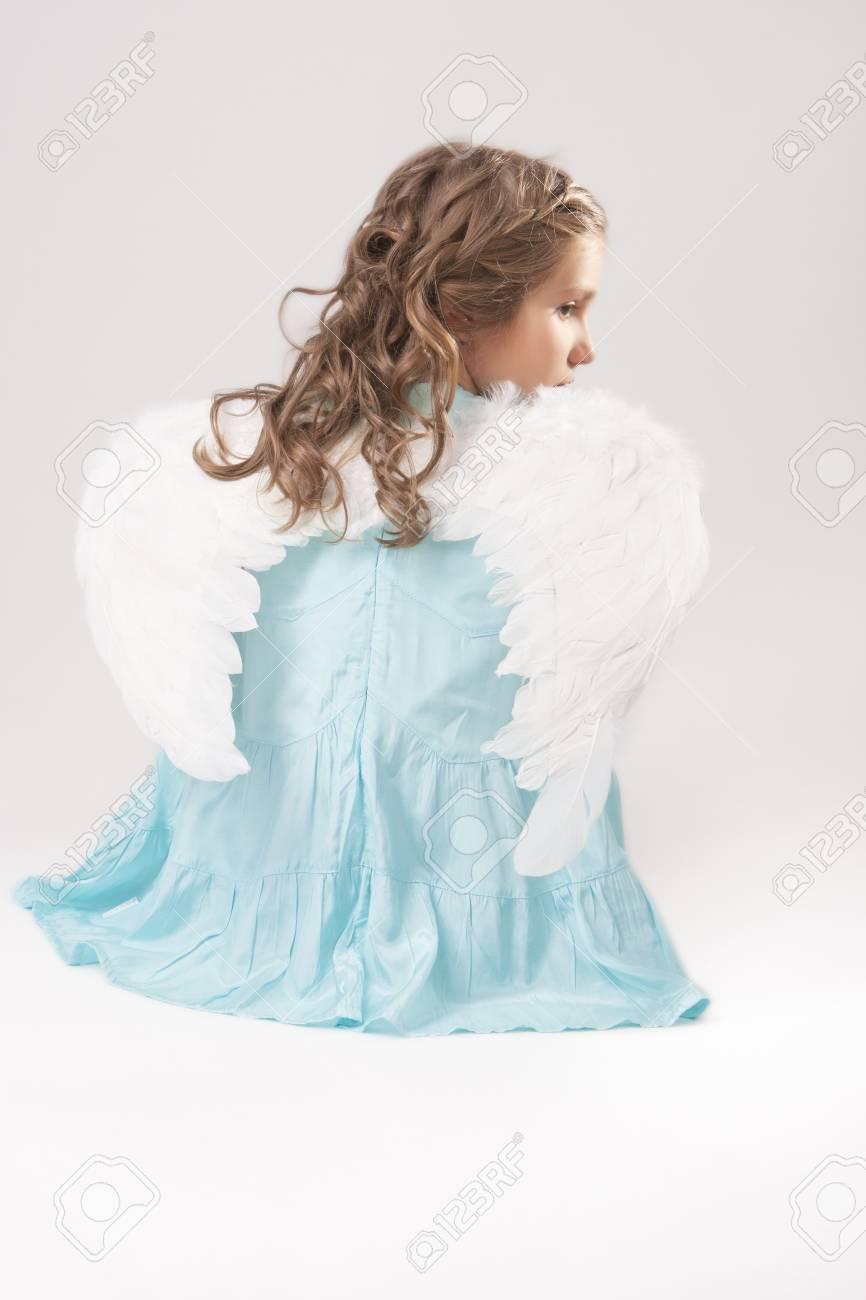 cute lovely portrait of angel girl sitting over white background Stock Photo - 17041565