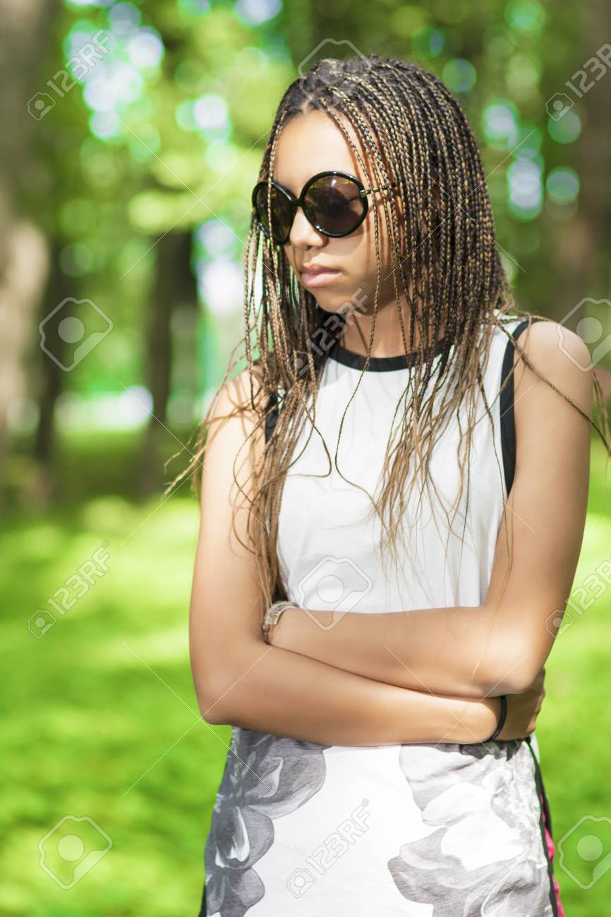 Stock Photo - Teens Lifestyle Concepts and Ideas. African American Teenage  Girl With Long Dreadlocks Posing in Green Forest Outdoors.