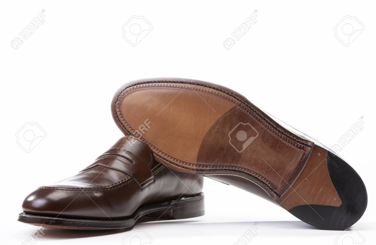 e36f5adc747 Pair of Stylish Brown Penny Loafer Shoes Against White Background with One  Item