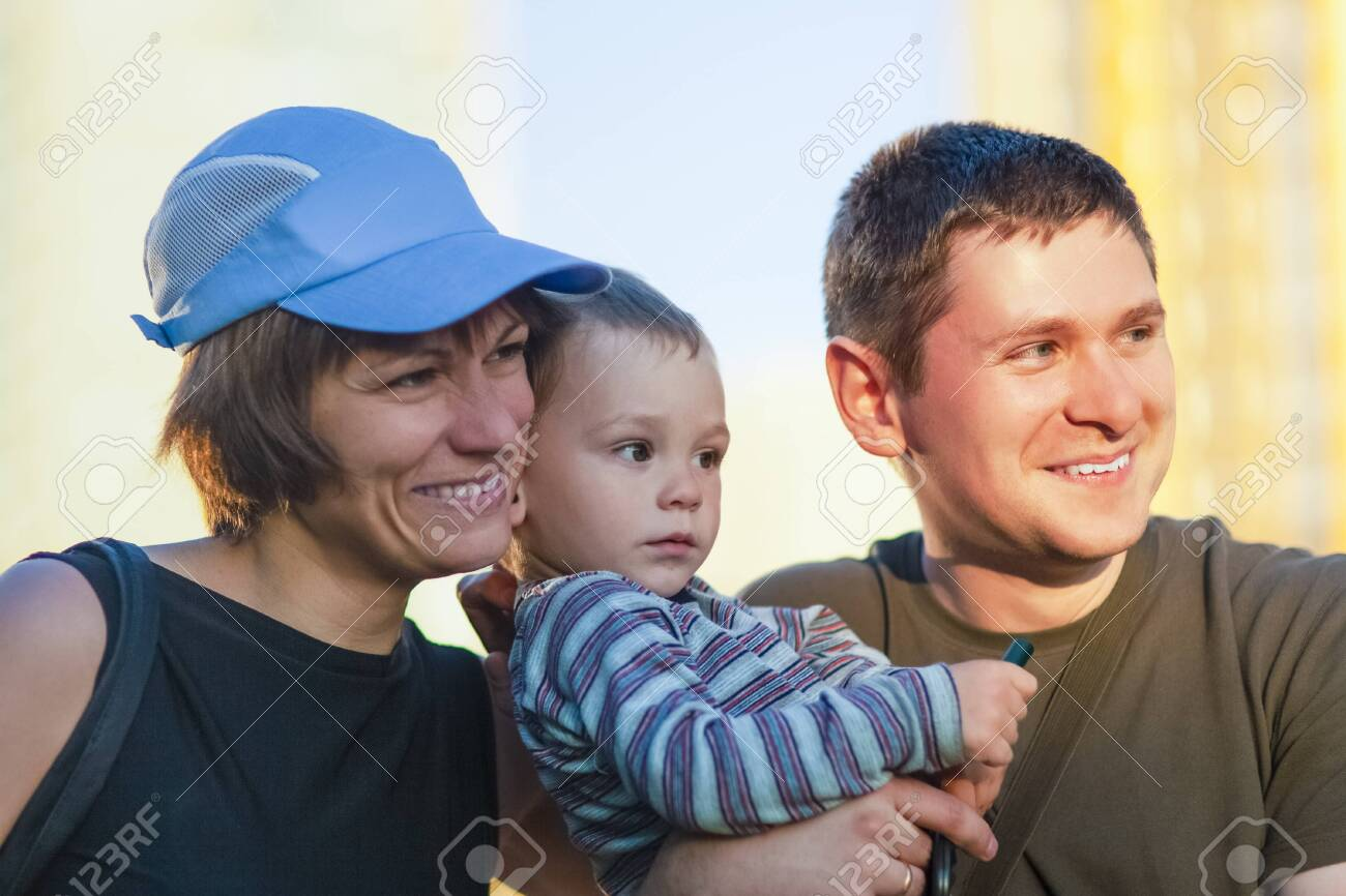Portrait of Young Caucasian Family of three Together Outdoors. Horizontal Image - 125722426
