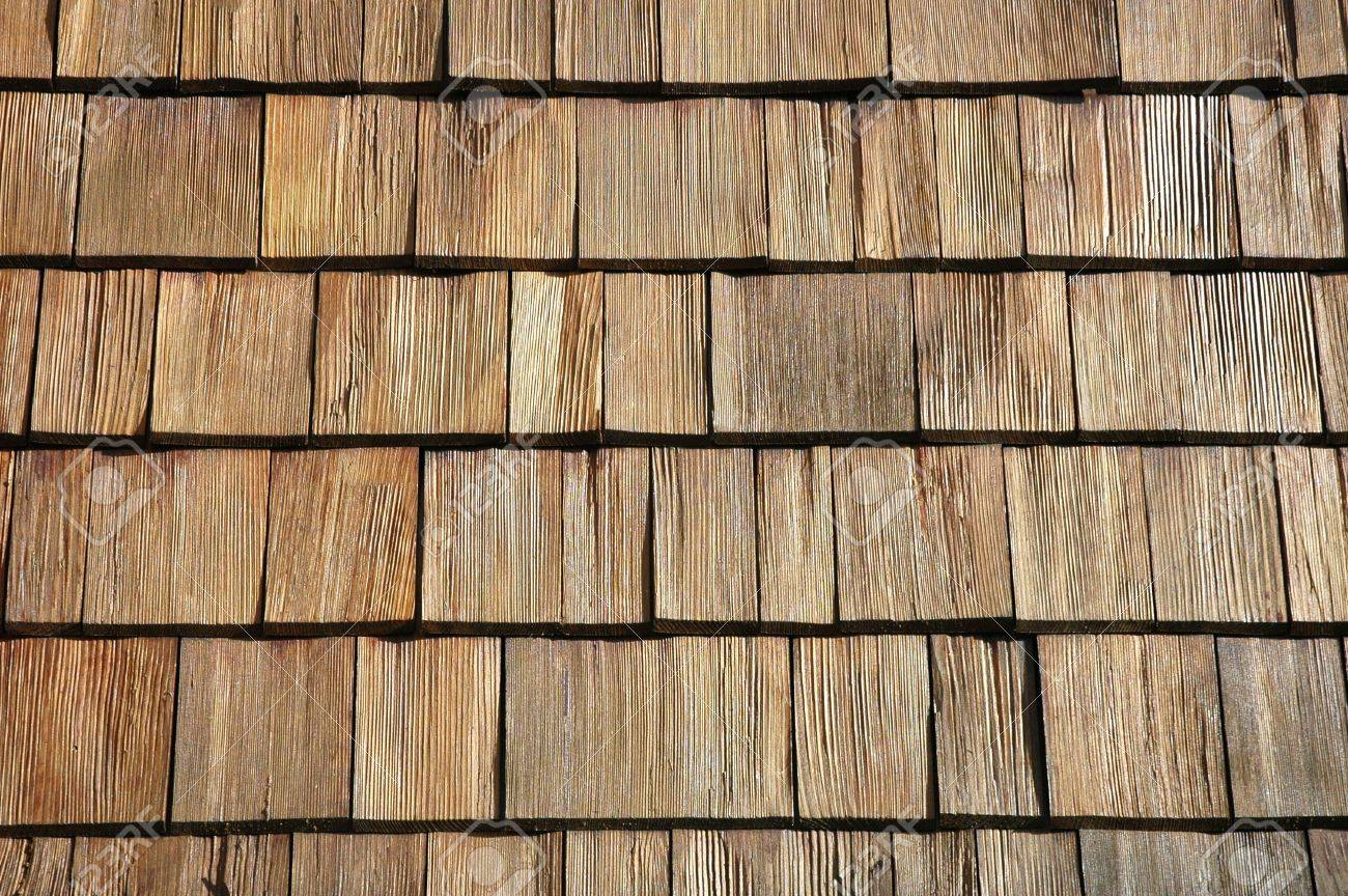 suelo de baldosas de madera sobre una pared de casa foto de archivo