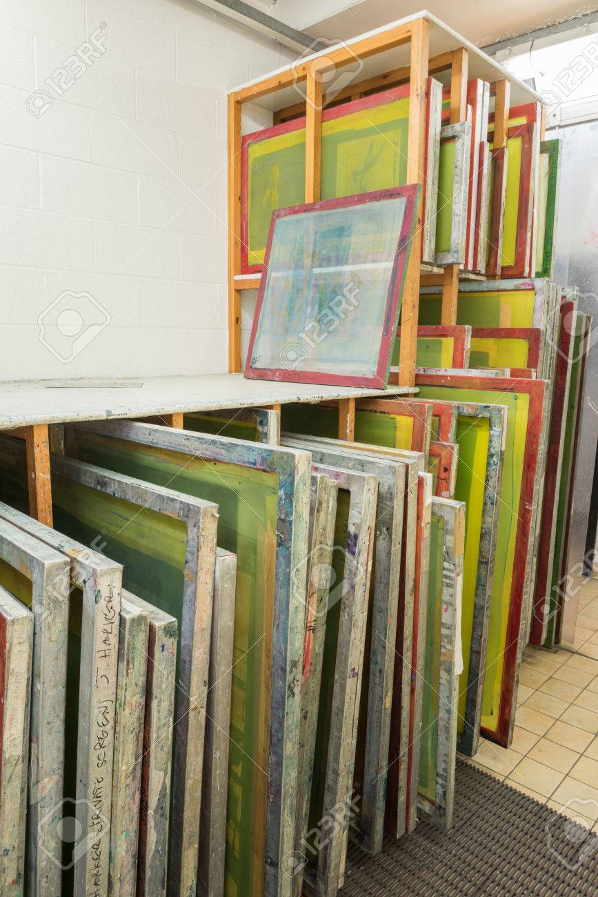 ab5565a4 Silk screen printing screens stored in a wooden rack ready for printing.  Stock Photo -