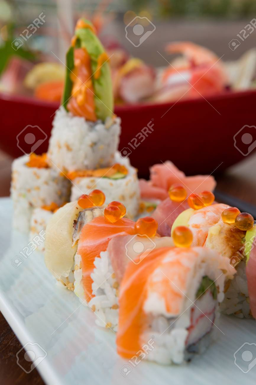 Fish egg and raw salmon sushi japanese food, served on a white