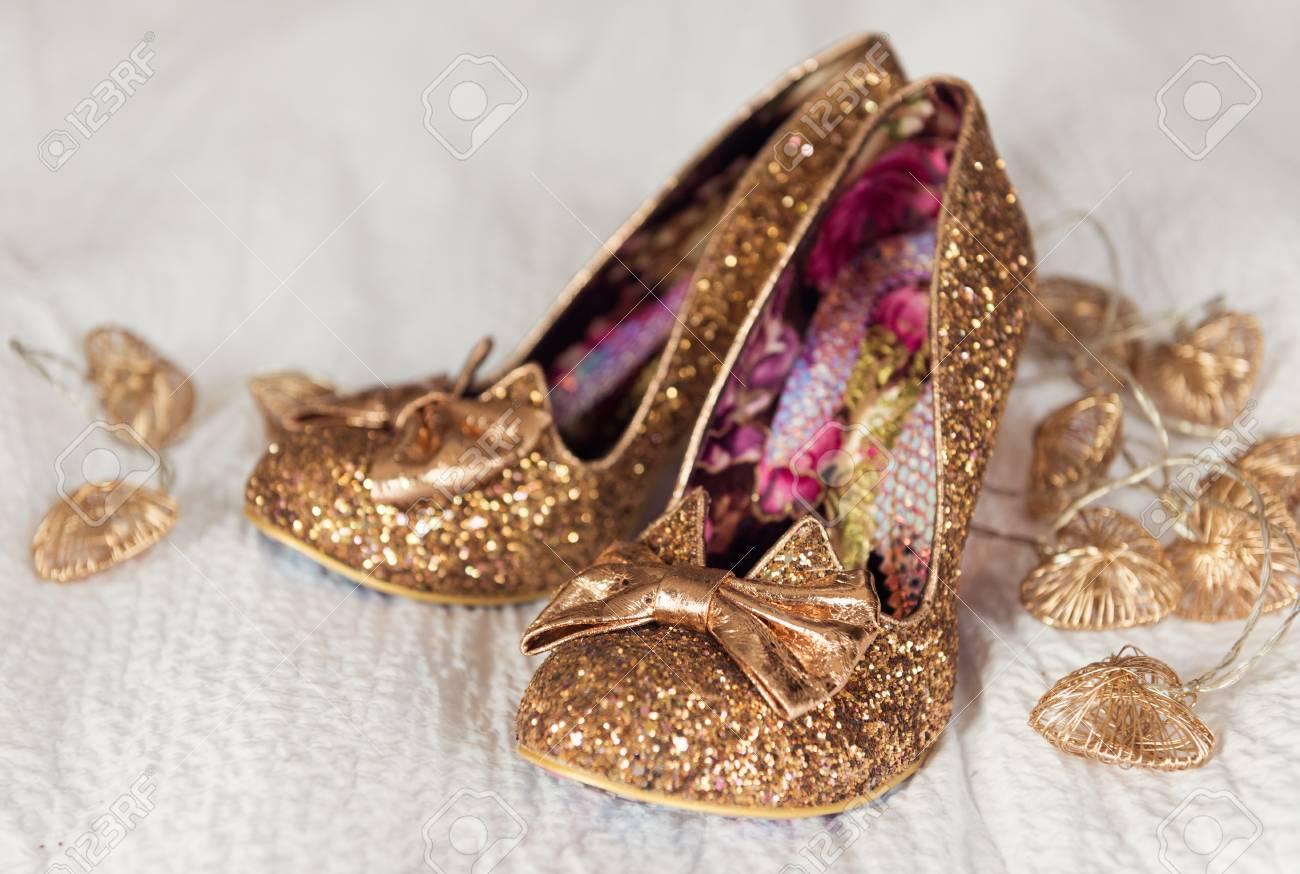 A Brides Beautiful, Golden, Glittery, Sexy Pair Of Individual Stylish Wedding  Shoes,